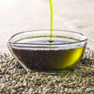 Hemp seed oil being poured